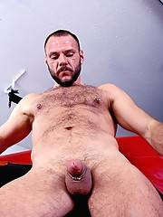 Bear stud pushes huge dildo deeper into his massive hole taking more and more up his big puckered ass