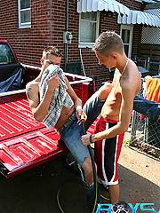 Two sporty boys team up to wash their red truck and end up sucking cocks and fucking in a garage