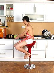 Charming twink with hairy uncut cock posing on a kitchen countertop in his sexy barbecue apron