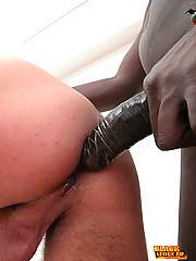 Black seducer works his 13-inch cock deep down skinny white boy's ass