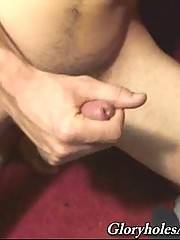 Curly long haired dude enjoys glory hole sucking until gains cumshot.