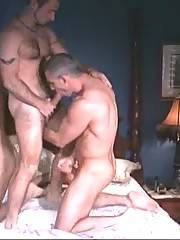 Sexy muscled lovers give each other passionate blowjob.