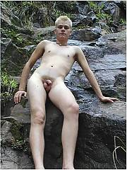 Twink outdoors masturbating in public park