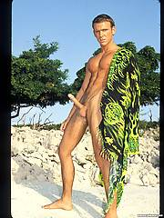 Daddy Kevin Cage rock hard abs glisten in the sunlight as he lays in the ocean