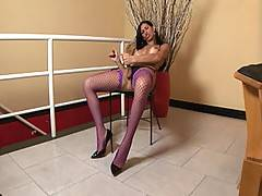 Brunette beauty Renata looks so innocent when things kick off in this video. Don't worry, she's not. Within moments she's running her fingers through that beautiful hair and playing with that yummy, uncut tool by rubbing it between there long legs.