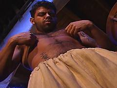 Manuel Torres finds his night watch dull. No criminals, no passersby, no nothing... He notices a stir in his crotch and looks down. He feels his growing cock un...