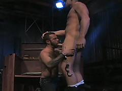 Slammed against a wall and handcuffed by Sergeant Scott Tanner, Steve Cruz is put at the mercy of his rough captor, but we all know that's just how Steve prefers it. He starts by deep-throating Scott's thick cock before chowing down on his blond, furry bu