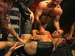 About the only thing better than being surrounded by this tattooed, pierced, well-built and leather-loving ensemble of hunks is being fisted by them. Which is exactly what happens to lucky bottom Michael Ray. And who better to be in the experienced hands