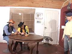 Two cowboys pay for their drinks by fucking a blond bartender raw and cumspraying his pretty face