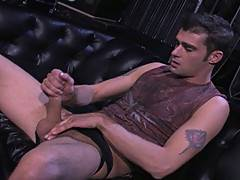 Jason Crew is no stranger to working the camera. He struts his stuff, cocksure and cock ready to show off. Jason shucks his jeans on a black leather sofa and st...
