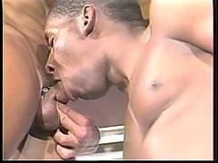 Deep throating a big black cock