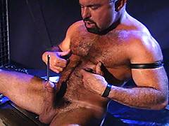 In this solo Steve Parker demonstrates the fine art of sound play. His cock is as hard as the steel rod he slides down his piss hole. Slowly, steadily you see t...