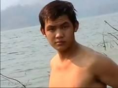 Kana tanning his sexy body on the beach