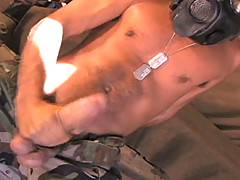 Still wearing a gas mask and some of his army garb, Antonio Biaggi gets out his huge done for a wild solo performance. He jerks that tool like he's been waiting to whack off for years and grunts like a wild animal as he pumps it in his tent. If you like t