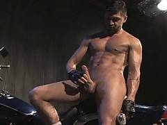 Dominic Pacifico is riding his motorcycle through the city streets at night. The powerful engine is revving between his thighs, vibrating his ass and big balls. His mind starts to wander. He imagines himself straddled naked over his bike. He strokes his b
