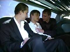 Three cute twinks continue wedding celebration by sucking each other's cocks in a limo
