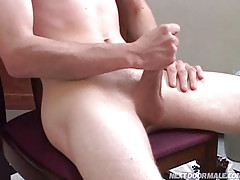 Cute twink playing around with himself in the kitchen