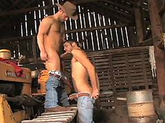 Up on top of a tractor, RJ Danvers sets to work on Tristan's big cock, lubing it and his balls up with saliva while jerking himself off. Tristan gets really wo...