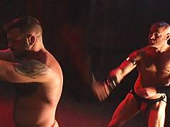Here we find Danny Mann playing whipping boy to muscle daddy supreme Ken Braun. The two waste no time and Mann hangs onto a post, presenting his back to the flo...